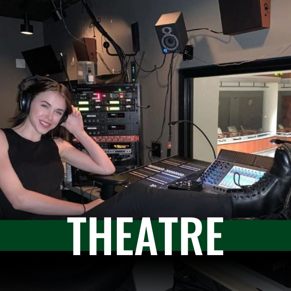 photo of a women running the sound booth for a theatre performance