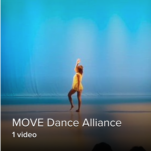 a solo shot of a female dancer in yellow standing against a blue background