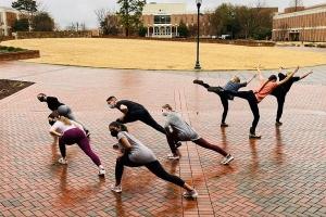 dancers performing outside at Belk Plaza