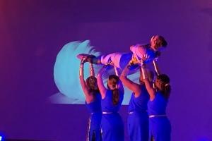 dance students holding mummy aloft